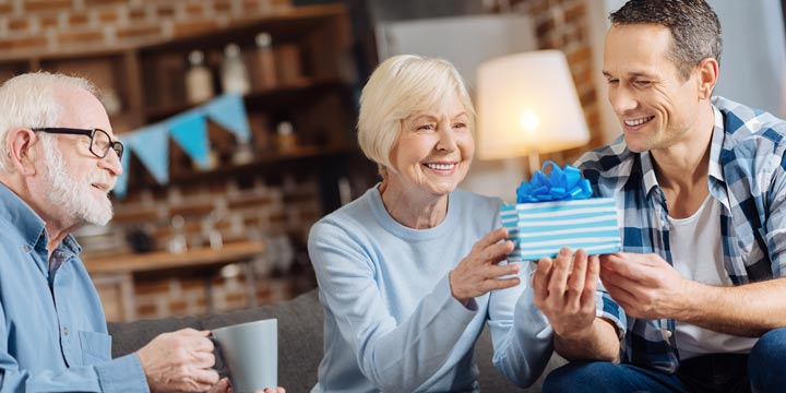 Happy Parents Opening Gift From Son Home Articles Gifts For Elderly People