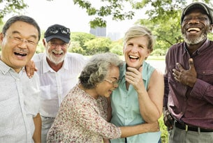 Group of Seniors Laughing Together Outside