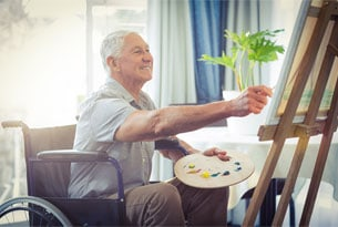 Retired Man Working on a Painting