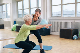 Senior Woman Working Out with Her Trainer